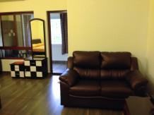 Vanity, door into yoga room, and comfy couch.