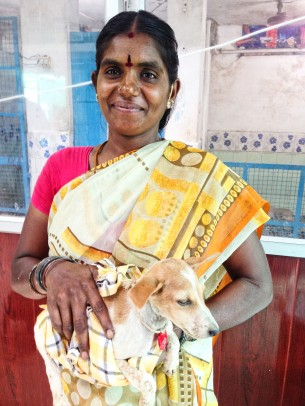 Chennamal with one of the orphaned puppies at the Arunachala Animal Shelter.