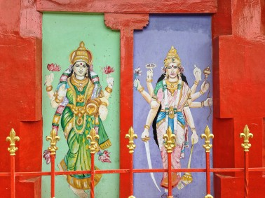 Glamorous goddesses on the side of a temple.