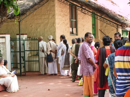 Lining up for a meal at the ashram dining room. Photo by Alan.