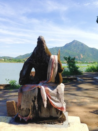 The sage gazes across the water at Annamalai.