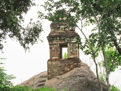 Tiny temple on top of a huge boulder. Photo by Alan.