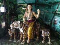 Ayyappa riding a tiger.