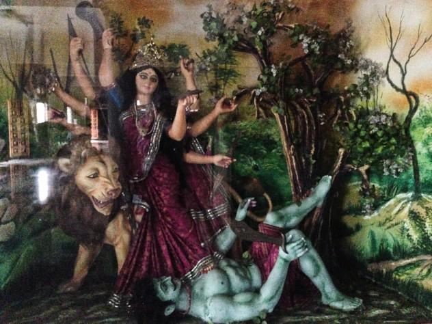 Durga quelling a demon.