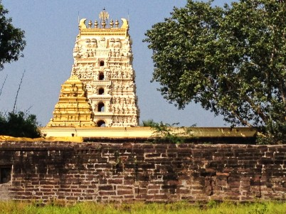 Main gopuram and a gilded smaller gopuram viewed from outside temple walls.