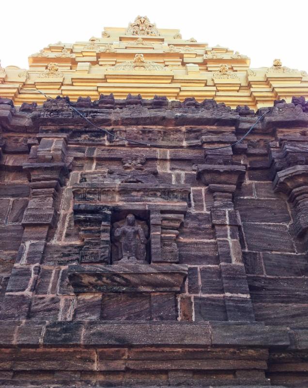 Old stone walls, new gilded plasterwork at Sri Bhavananarayanaswamy temple.