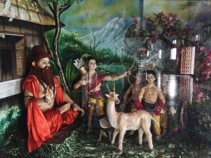 Ayappa as a boy with a sage in the forest.