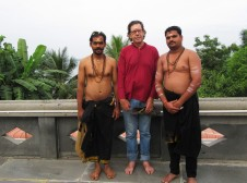 Swami Prasad on the left, Alan in the middle, and another swami on the right.