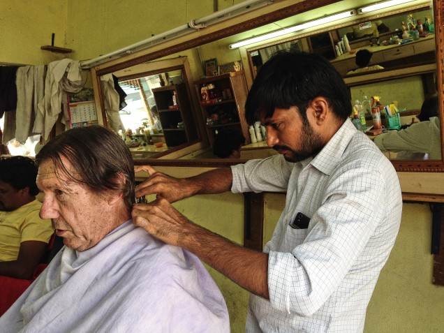 Alan at the barber, Bhadrachalam