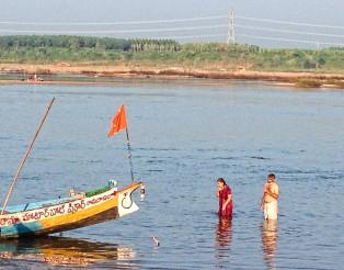 Taking a dip in the Godavari.