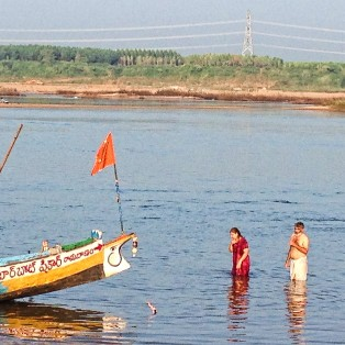 Taking a dip in the Godavari.