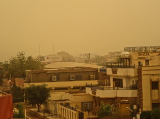 View of the street from our rooftop during the dust storm.