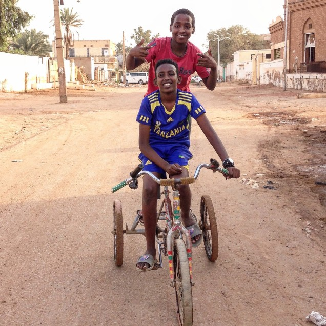 Two boys on a bike in Omdurman, Sudan