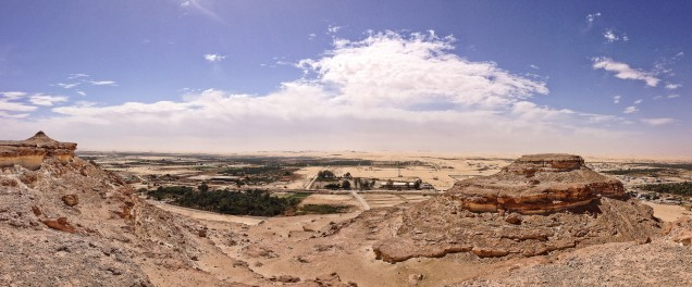 View of the southern part of Siwa Oasis, with part of Gebel el Dakrour in the foreground and the Great Sand Sea beyond the last of the oasis.