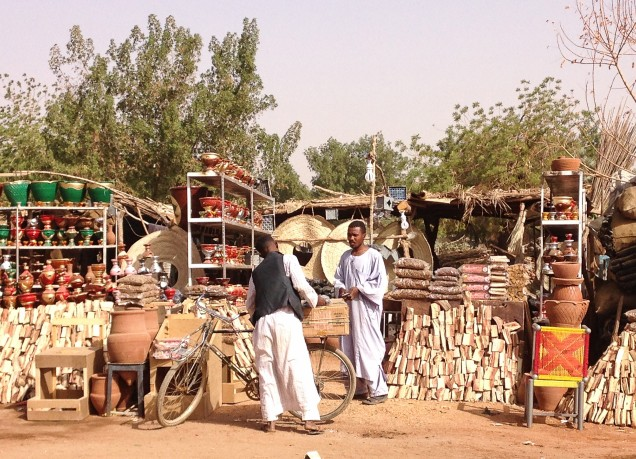 Selling firewood, charcoal, clay pots and other necessities at the small souk at Al Kabajab, Omdurman.
