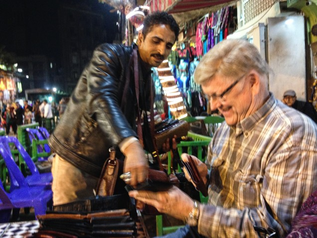 Tom negotiating for a new wallet  in Khan el Khalili, Cairo