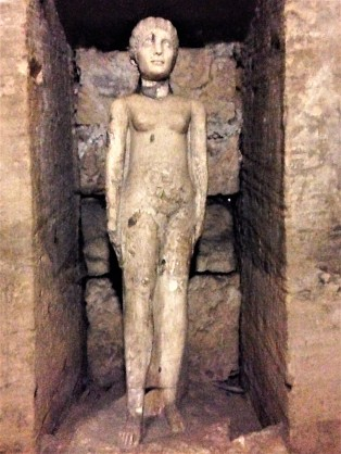 Depiction of a lady buried in the catacombs.
