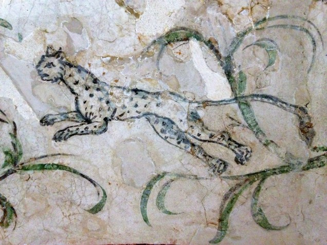 Painting of a leaping leopard in one of the aboveground tombs.