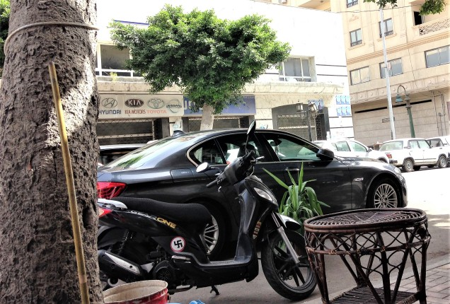 A motorcycle with a swastika sticker, Alexandria, Egypt