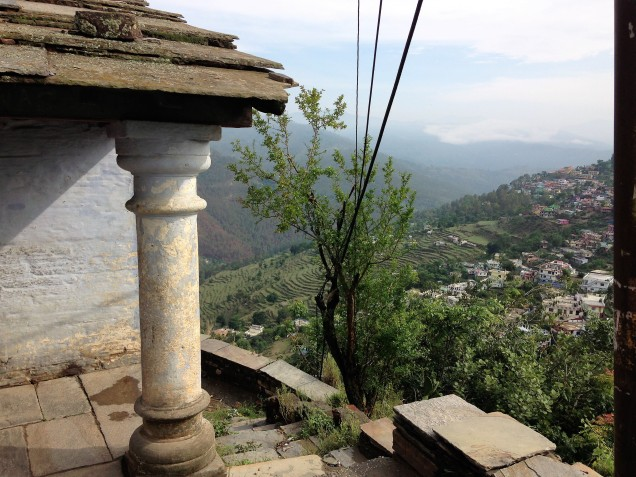 Corner column of an old house perched high above the valley that cascades from Almora's ridge, Uttarakhand