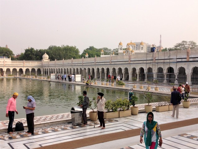 Morning worshippers at the holy pond of Gurudwara Bangla Sahib, New Delhi