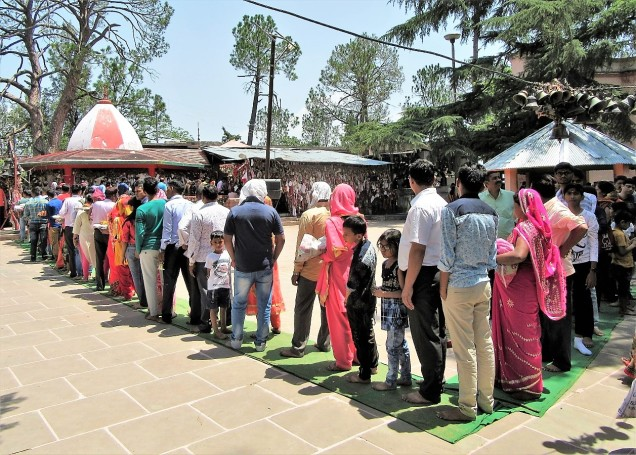 Queue of visitors waiting for darshan at Chitai Golu Devta Temple, Almora, Uttarakhand