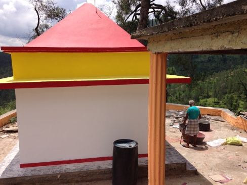 New temple with workman applying finishing touches, Bintola valley, Almora, Uttarakhand
