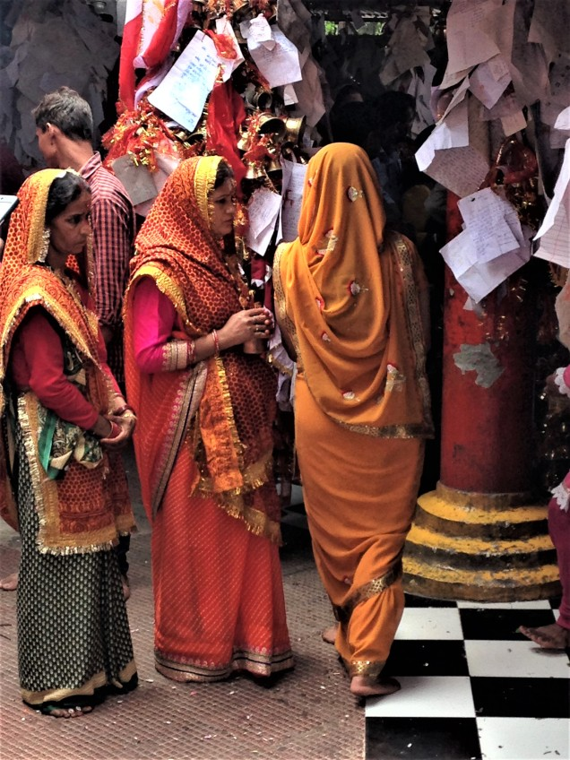 Ladies wearing special temple-visit shawls at Chitai Golu Devta Temple, Almora, Uttarakhand