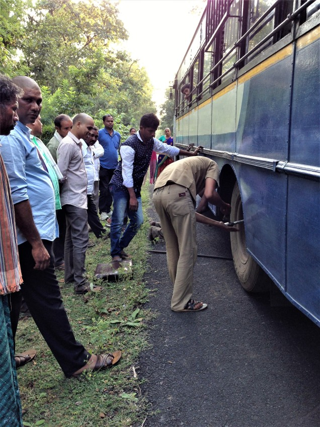 Changing the wheel of the bus in eastern ghats, Andhra Pradesh
