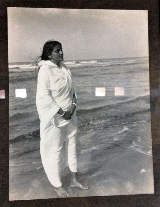 Ma Anandamayi by the sea. A photo in the meditation hall at the Ma Anandamayi Ashram, Patal Devi, Almora, Uttarakhand.