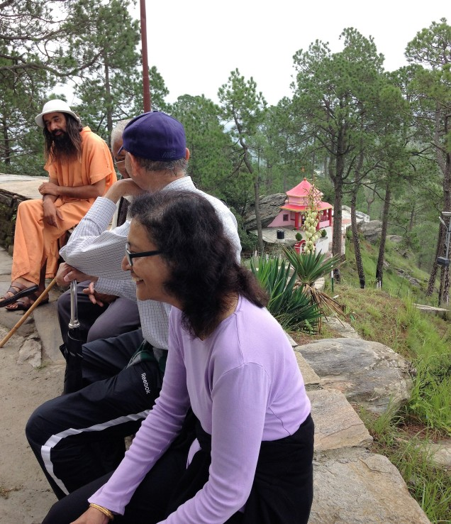 Nayana, Prashant and the resident swamiji at Kasar Devi Mandir, Almora, Uttarakhand.
