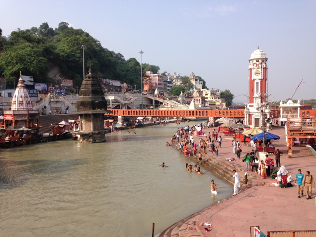 The Ganga canal with the famous clock tower and temples. Haridwar, Uttarakhand.
