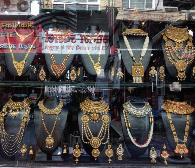 Photo of elaborate gold jewelry in a jeweler's window in Sarafa Bazaar, Indore, Madhya Pradesh.