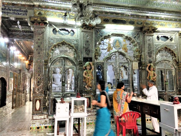 The Kanch Mandir, a Jain temple in Indore, Madhya Pradesh. Its interior surfaces are all encrusted with glass: walls, floors, pillars, ceilings, altar niches.