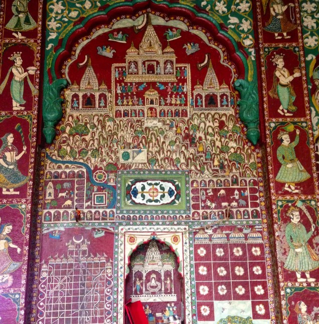 Highly detailed wall mural in the white-and-gold Jain temple, Indore, Madhya Pradesh.