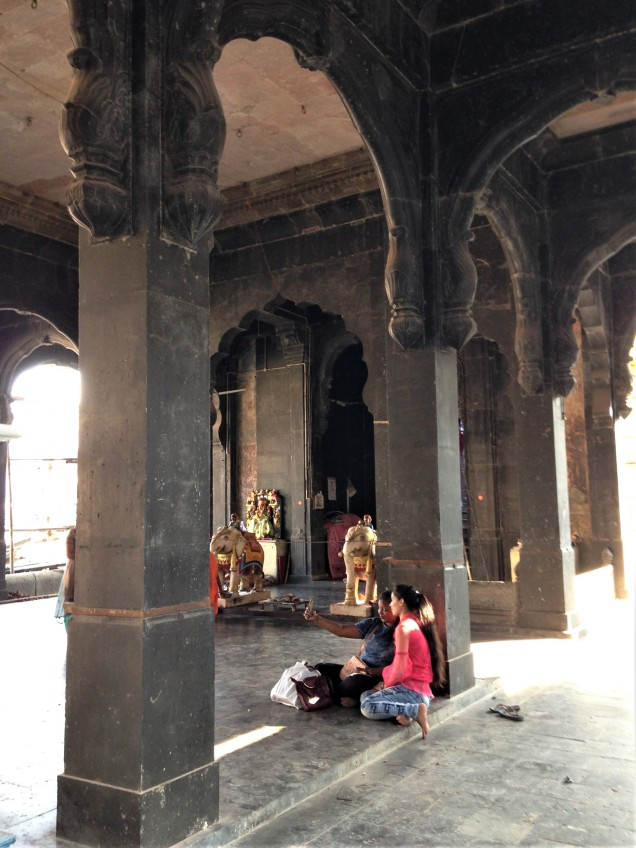 Old Krishna temple in Indore, Madhya Pradesh, and girls relaxing and taking selfies.