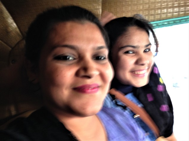 Photo of a mother and daughter who jumped into our rickshaw in Indore, Madhya Pradesh.