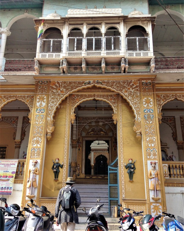 Photo of exterior of white and gold Jain temple, Indore, Madhya Pradesh.