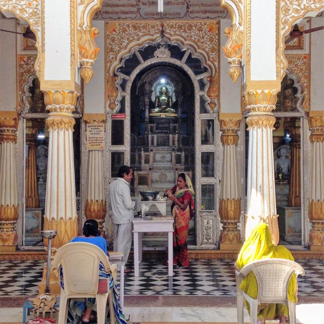 Interior of white-and-gold Jain temple.