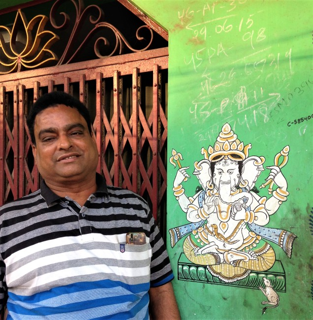 Our new Brahmin friend, pictured with a painting of Ganesh. Puri, Odisha