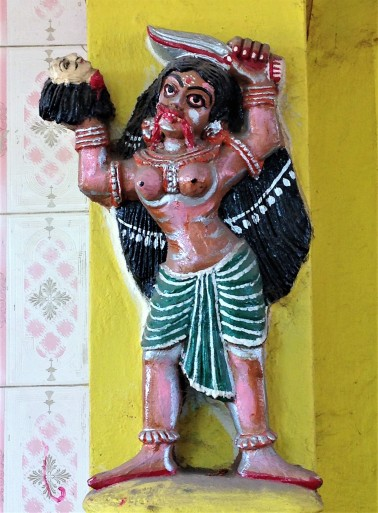 Sculpture of Kali at entrance to burning ground, Puri, Odisha