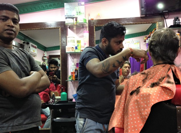 Many of the barber's buddies in barbershop, Puri, Odisha