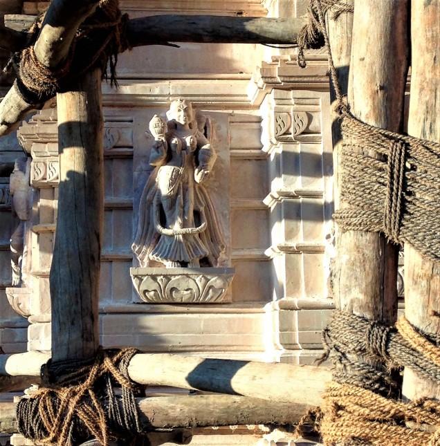 Single sculpture on the Jain temple tower, with scaffolding. Amarkantak, Madhya Pradesh.
