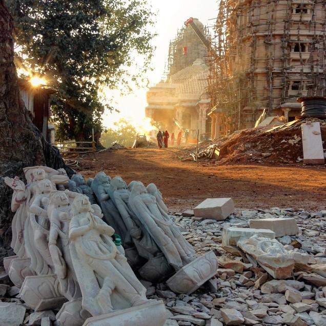 Unfinished sculptures in the foreground, Jain temple beyond. Amarkantak, Madhya Pradesh.