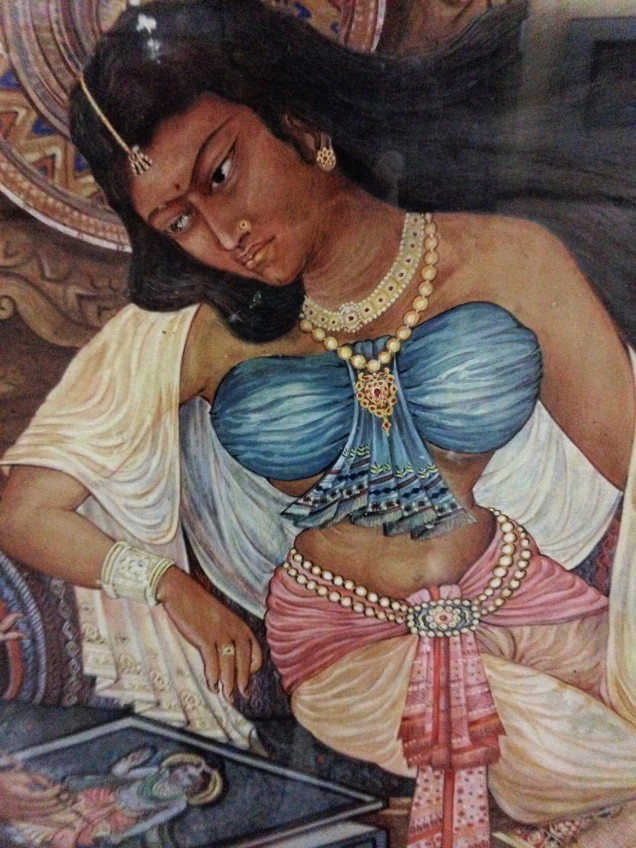 Detail from painting of  a lady and a lady artist. This is the lady watching the artist as she paints. Assam State Museum, Guwahati, Assam