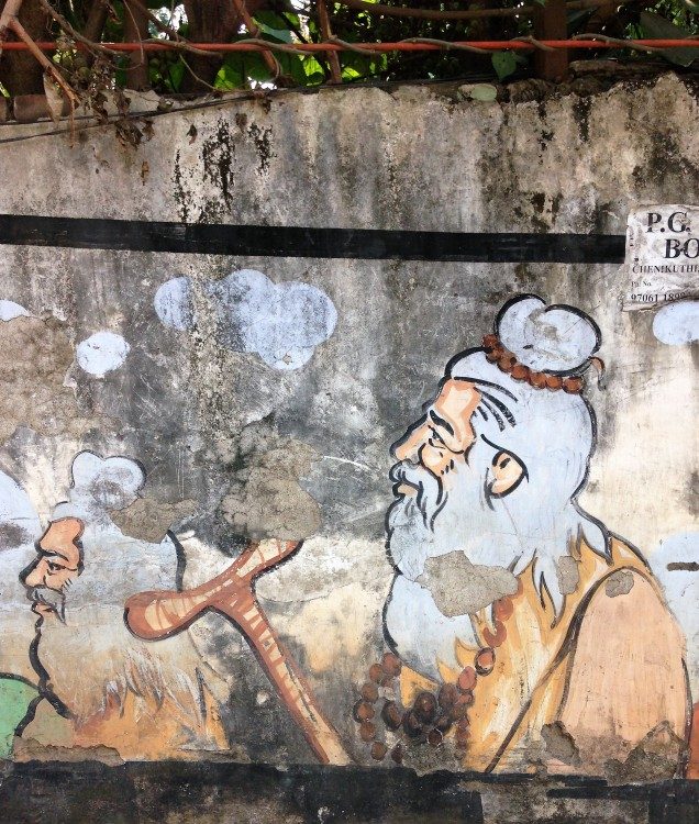 Two rishis depicted in a wall mural in Guwahati