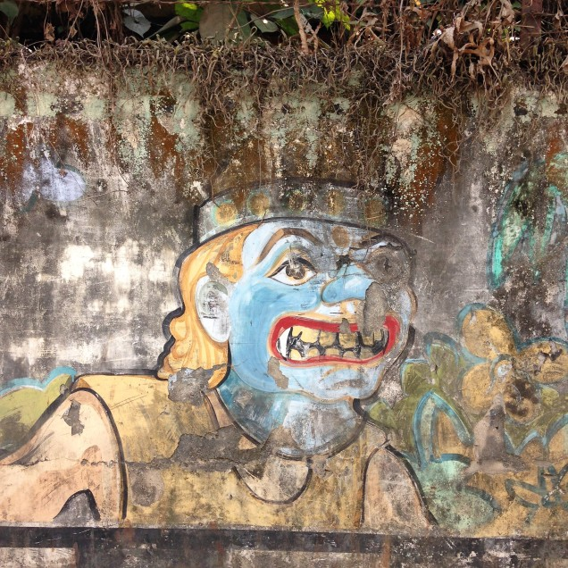 Theatrical mask on an actor, wall mural, Guwahati