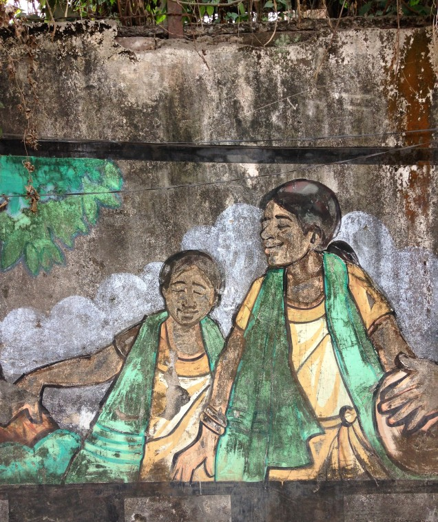 Two tea workers depicted on wall mural in Guwahati