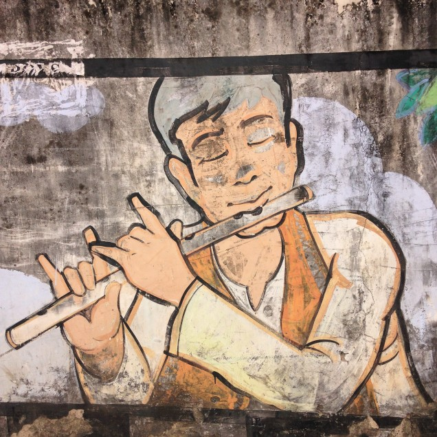 Flute player on wall mural, Guwahati