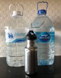 Photo of our two big 6-liter bottles and my half-liter bottle -- 13 liters of drinking water. Chiang Mai